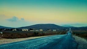 Дорога гористой местности к безграничности Стоковые Изображения RF