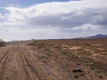 Дорога гравия - Фуэртевентура, Canaries, Испания Стоковые Изображения