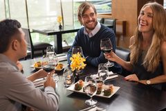 Друзья в ресторане Стоковая Фотография RF