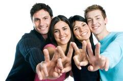 друзья собирают счастливая успешную Стоковое фото RF