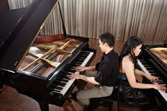 Дуэт с роялями Стоковая Фотография RF