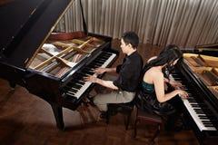 Дуэт с роялями Стоковое Изображение