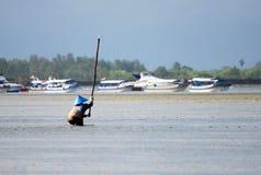 巴厘语捕鱼 免版税库存照片