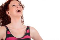 头发的快乐的红色妇女年轻人 免版税库存照片
