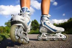 轴向直排轮式溜冰鞋冰鞋 免版税库存照片