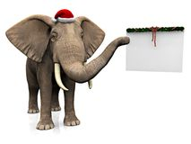 戴圣诞老人帽子的大象。 库存图片
