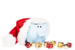戴圣诞老人帽子的存钱罐 免版税图库摄影