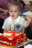 婴孩吹的蜡烛  库存照片
