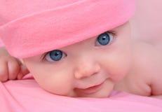 婴孩大眼睛女孩一点粉红色 免版税库存图片