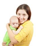婴孩她的小母亲 免版税库存图片