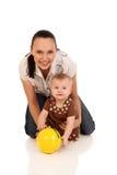 婴孩笑的母亲使用 免版税库存图片