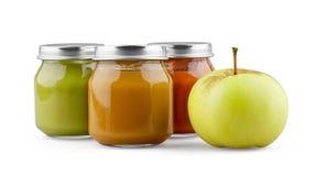 婴孩纯汁浓汤和苹果 图库摄影