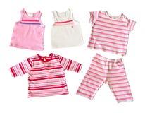 婴孩给女孩穿衣查出 免版税库存照片