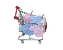 婴孩给购物穿衣 免版税库存图片