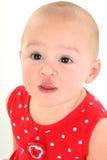 婴孩美丽的叮咬女孩嘴唇鹳较大 免版税库存图片