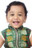 婴孩逗人喜爱印第安笑 免版税库存图片