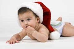 婴孩逗人喜爱的圣诞老人 免版税图库摄影