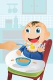 婴孩饲养时间 库存图片