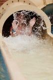 水滑道的男孩 免版税图库摄影