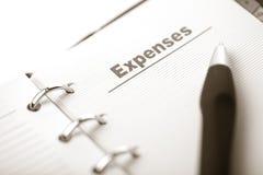 费用查出组织者页笔 免版税库存照片