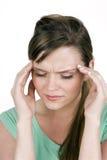头疼妇女 免版税库存照片
