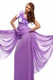 紫色礼服的妇女 免版税库存图片
