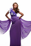 紫色礼服的妇女 库存照片