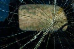 破裂的玻璃窗背景裂缝 库存图片