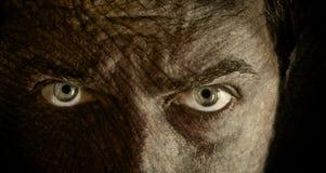 破裂的眼睛面对可怕皮肤 免版税库存照片