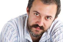 年轻人的胡子接近的人 免版税库存图片
