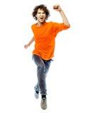年轻人运行的screamming的愉快的正面图 免版税库存照片