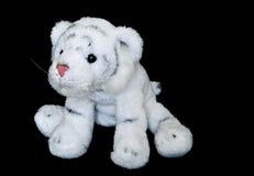 崽逗人喜爱的长毛绒老虎玩具白色 库存图片