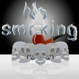 头骨和管道抽烟 库存图片