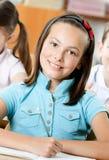 兴高采烈的美丽的女小学生 免版税库存图片