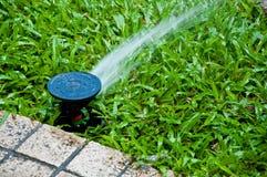 洒水装置 免版税库存照片