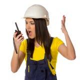 0 εργαζόμενος που κοιτάζει σε walkie-talky Στοκ Εικόνα