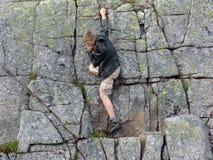 01个登山人岩石 库存图片