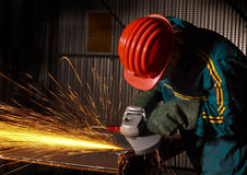 02台研磨机重工业体力工人 库存照片