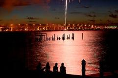 07-04-06 Stuart, FL fireworks (25). People  (in silhouette) watching fireworks by Roosevelt Bridge, July 4th 2006 in Stuart, FL Stock Photography