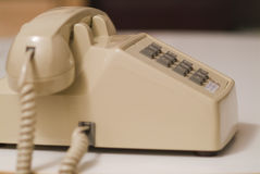07 biege更旧的电话 库存图片