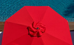 074 One Red Umbrella. Red Umbrella Poolside at Resort Royalty Free Stock Images