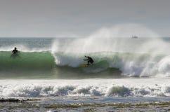08 som surfar Arkivbilder