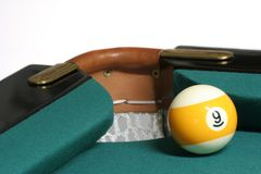 09 ball corner pocket. Pool ball number 09 in pool table near corner pocket royalty free stock images