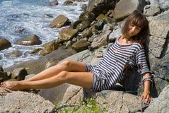 1个岩石妇女年轻人 免版税库存图片