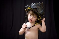 1个消防队员小孩 免版税库存图片