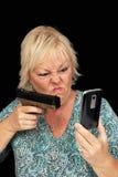 1个白肤金发的电池手枪成熟电话 库存照片