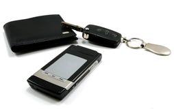 1个黑色汽车关键字移动电话钱包 免版税库存照片