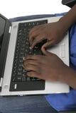 1台计算机递关键董事会膝上型计算机人 免版税库存照片