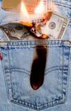 1 καίγοντας τρύπα η τσέπη μο&upsilo Στοκ εικόνες με δικαίωμα ελεύθερης χρήσης