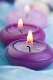 1 πορφυρό μετάξι κεριών μωρών &mu Στοκ Φωτογραφία